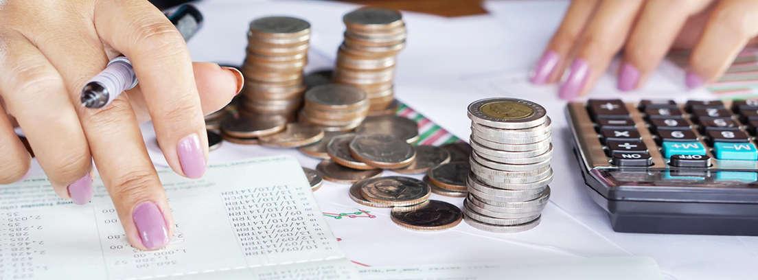 Businesswoman building growing one euro columns, saving money concept