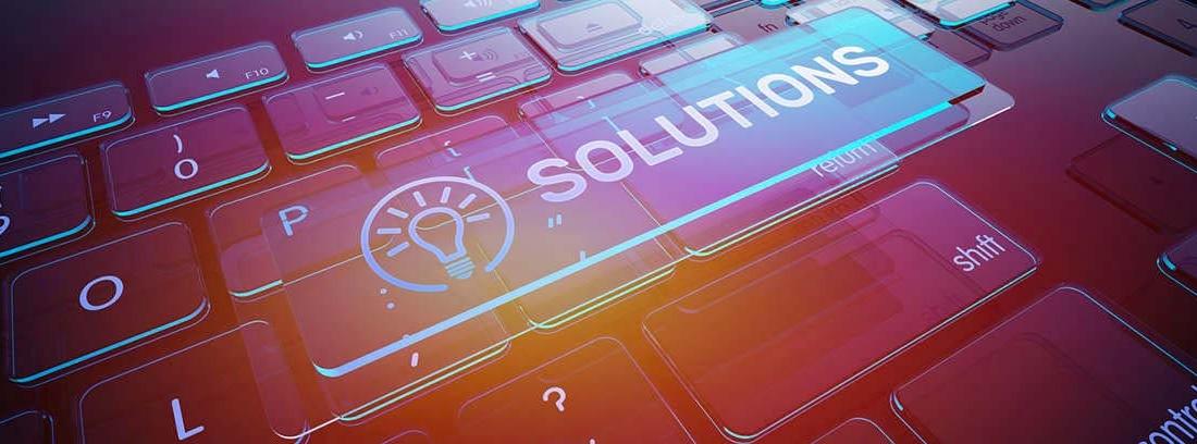 """Palabra """"solutions"""" sobre un teclado"""