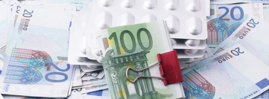 Billetes de euro y pastillas