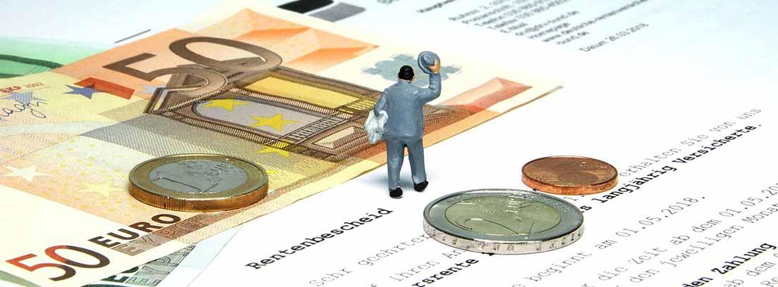 Miniaturas de personas cobre papeles y billetes
