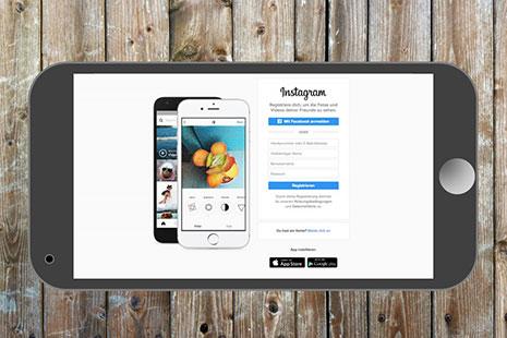 Teléfono móvil con la página de inicio de Instagram
