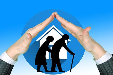 Dibujo de dos personas mayores con una casa al fondo y dos manos juntas formando el tejado de una casa
