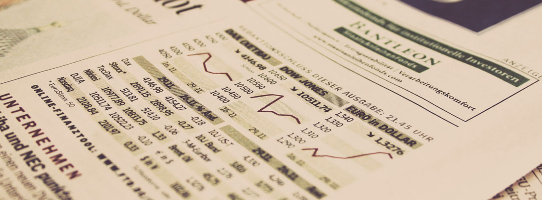 Portada de periódico económico con gráficos y cotizaciones
