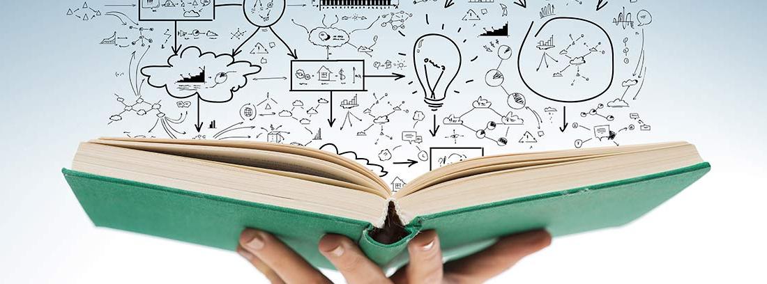 Mano de mujer sujetando un libro abierto del que salen dibujos relacionados con la educación financiera