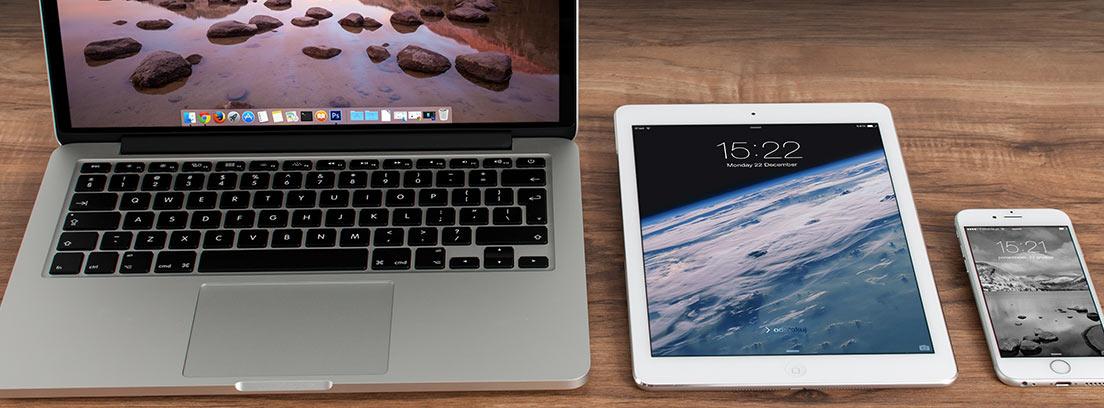 Un ordenador, una tableta y un smartphone marca Apple